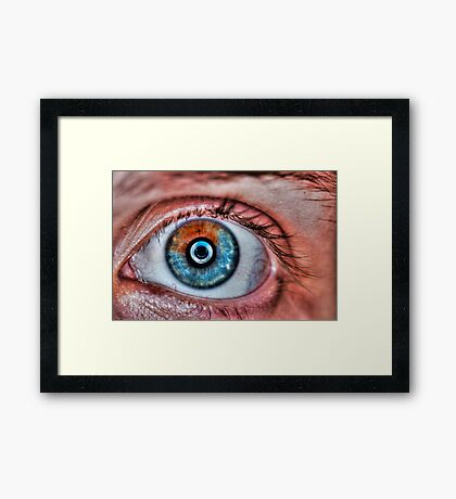 Extreme closeup of a human eye brown, and blue Framed Print