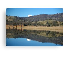 reflection in the water of the hills Canvas Print