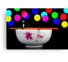 Circus balance game on chopsticks Canvas Print