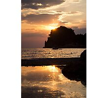 Last rays of sun reflect in the sea Photographic Print