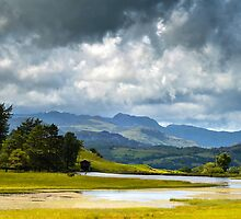 Dramatic Clouds over Langdale Pikes by a h