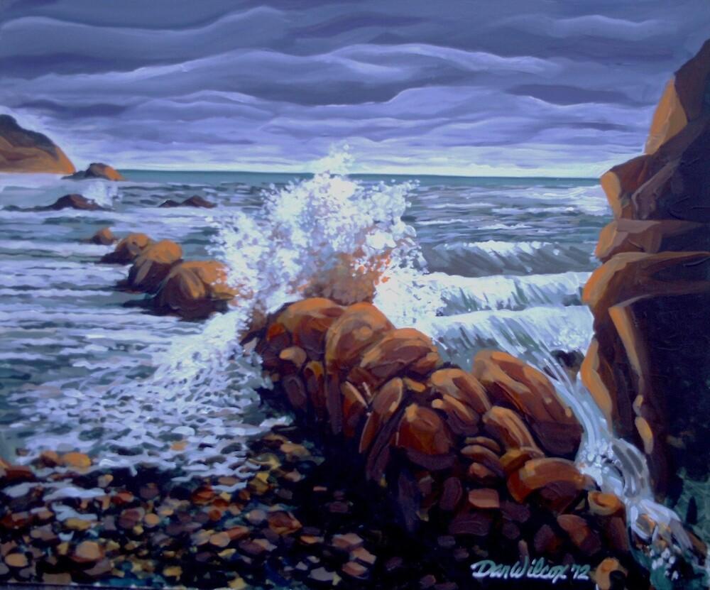 Tide comes in on rocky shore by Dan Wilcox