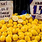 Lemons At A Street Market by Kuzeytac