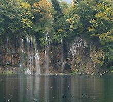 Waterfall on rock by pisarevg