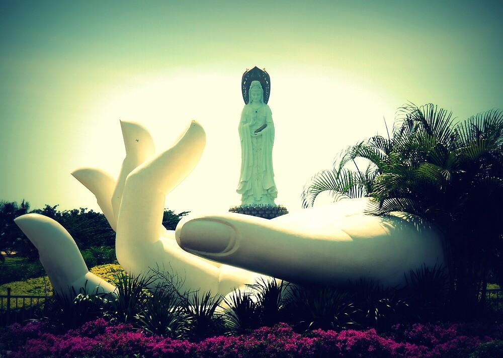 Varada Mudra hand sculpture and Guanyin statue, Sanya, China by Chris Millar