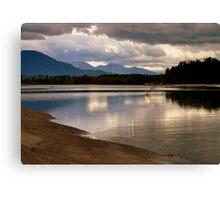 reflecting at the river Canvas Print