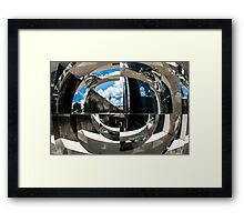 Reflection of building in an odd shaped mirror. Framed Print
