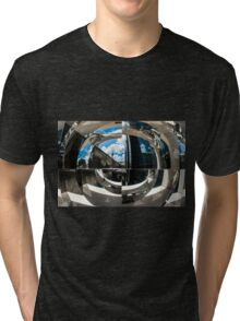 Reflection of building in an odd shaped mirror. Tri-blend T-Shirt