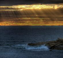 sunlight streaking through a gap in the clouds by BigAndRed