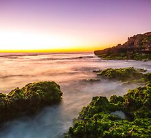 Sunset over the rocky coast by RedTreePhoto