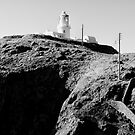 Lighthouse on the Headland by Dean Gale