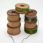 wooden spools by Lynne Prestebak