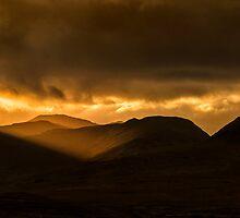 Maamturk sunset Connemara Galway Ireland. by MickBourke