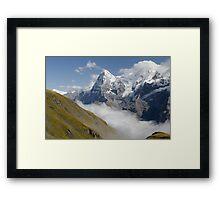 Verdant meadows below the Eiger in Switzerland Framed Print