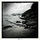 Sailboat off Chung Hom Kok beach by robigeehk