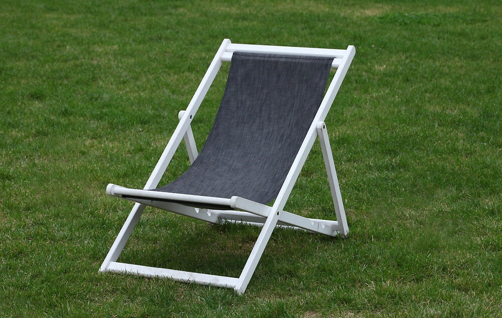 deck chair on green grass by mrivserg