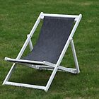 deck chair on green grass by mrivserg