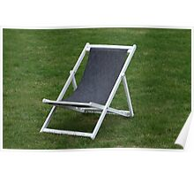 deck chair on green grass Poster