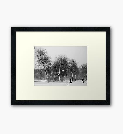Braving the snowstorm Framed Print