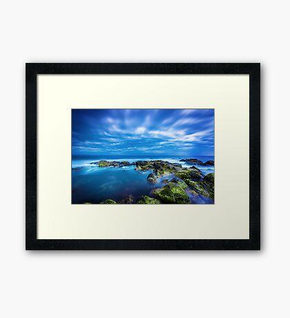 Dusk over calm blue sea over ocean and cloudy sky in Port Fairy, Victoria, Australia Framed Print