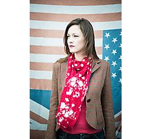Vintage fashion shot of young woman in front of US and UK flags Photographic Print
