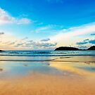dramatic scene of sunset on the beach by naphotos