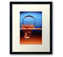 light bulb shot through the water Framed Print