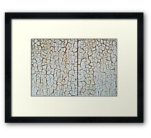 Rusty metal surface which has cracked from age Framed Print