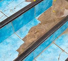 Top view of the stairs close-up of a broken blue tiles by vladromensky