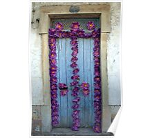 Old door decorated with purple paper flowers Poster