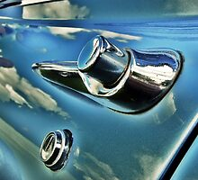 Vintage car door with clouds reflected by rgrayling
