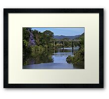 Jacaranda reflections in the Mary River. Framed Print
