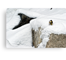 Hiker on snowy cliff Canvas Print