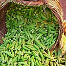 Okra Spilling From A Basket by Kuzeytac