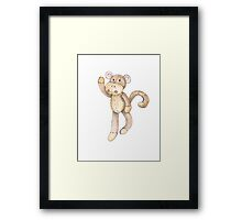 Hanging about sock monkey Framed Print