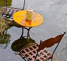 Submerged metal chairs and table by Michael Brewer