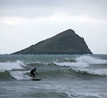Surfer and Great Mew Stone island, Wembury, near Plymouth, Devon, UK by silverportpics
