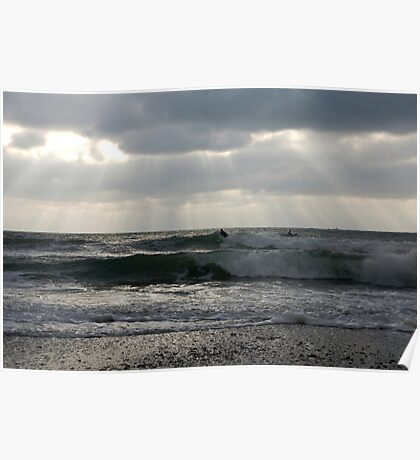 Surfers in winter with rays of sunlight, Wembury, near Plymouth, Devon, UK Poster