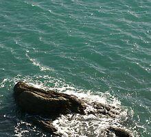 Blue waves and rock, Salcombe, Devon, UK by silverportpics