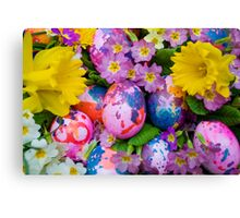 Easter eggs with daffodils and primroses Canvas Print