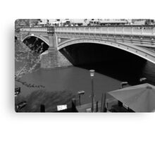 Bridge over muddy waters Canvas Print