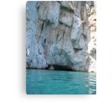 Greek Island Caves in water Canvas Print