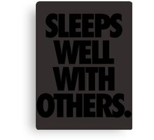 SLEEPS WELL WITH OTHERS. Canvas Print
