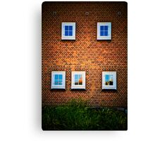 Five windows on a red tile wall Canvas Print