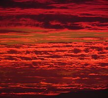 Red sunset over the mountains by Henry Murray