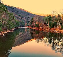 Mountain and setting sun reflection by Penny Rinker
