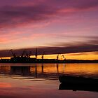 Beautiful sunset over the sea and shipyard by nrasic