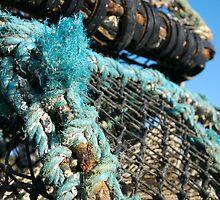 Lobster pots piled on harbourside, Salcombe, Devon, UK by silverportpics