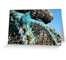 Lobster pots piled on harbourside, Salcombe, Devon, UK Greeting Card