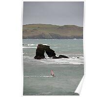 Windsurfer in stormy weather passes Thurlestone Rock, Devon, UK Poster